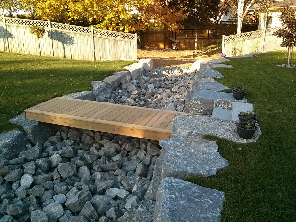 Armour stone st catharines landscaping retaining walls for Pool design retaining wall